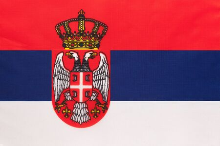 Serbia national fabric flag, textile background. Symbol of international european world country. Serbian state official sign. Stockfoto