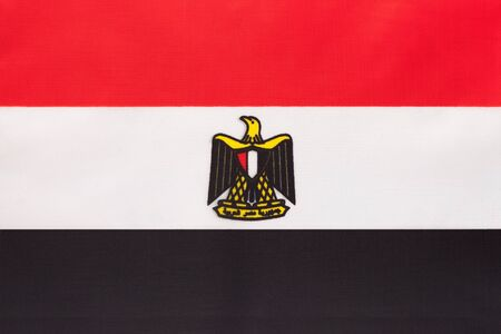 Egypt national fabric flag, textile background. Symbol of international african world country. Egyptian state official sign.