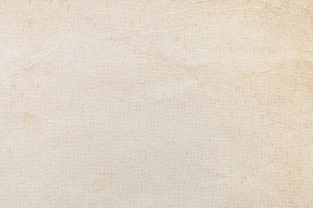Texture of beige old paper, crumpled background. Vintage white grunge surface backdrop. Structure of craft parchment cardboard.