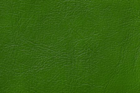 Dark green leather texture background, closeup. Emerald cracked backdrop from wrinkle skin, structure of textile. Фото со стока