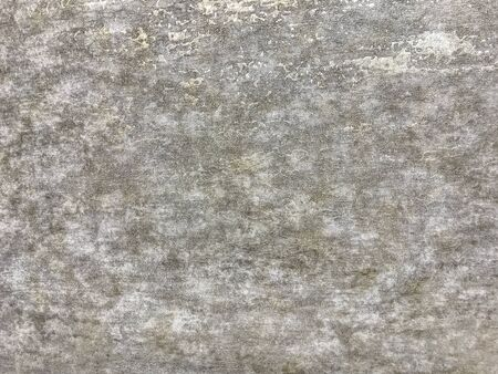 Texture of light gray wallpaper with a curly glossy pattern. Beige paper surface, structure closeup. Фото со стока