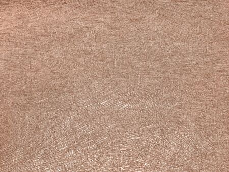 Texture of light brown wallpaper with a stripped pattern. Beige paper surface, structure closeup. Decorative backdrop.