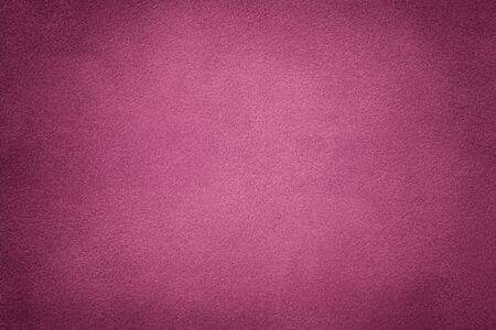 Background of dark purple suede fabric closeup. Velvet matt texture of wine nubuck textile with vignette. Stok Fotoğraf