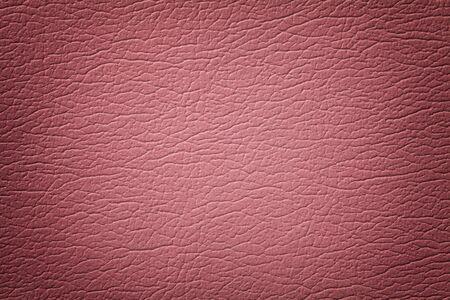 Dunkelrosa Leder Textur Hintergrund, Nahaufnahme. Rosa rissiger Hintergrund aus Faltenhaut, Textilstruktur mit Vignette. Standard-Bild