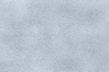 Background of light gray suede fabric closeup. Velvet matt texture of silver nubuck textile. Reklamní fotografie