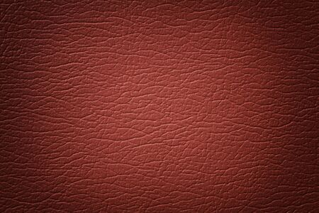 Dark orange leather texture background, closeup. Brick cracked backdrop from wrinkle skin, structure of brown textile with vignette.