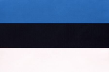 Estonia national fabric flag, textile background. Symbol of international world european country. State Estonian official sign.