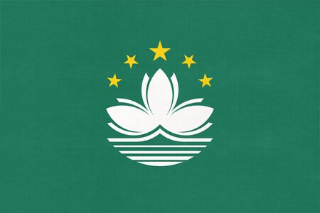 Macao national fabric flag, textile background. Symbol of international asian chinese world country. Macau state official sign. Reklamní fotografie