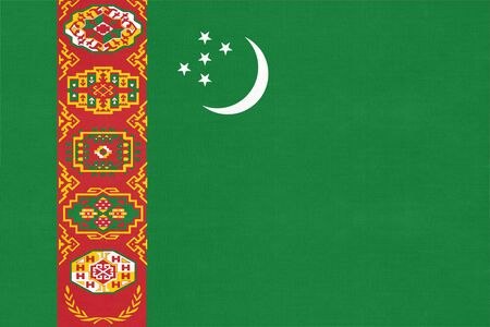 Turkmenistan national fabric flag textile background. Symbol of international world Asian country. State official turkmen sign.