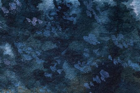 Abstract art background navy blue colors. Watercolor painting on canvas with green stains and gradient. Fragment of indigo artwork on paper with pattern. Texture backdrop, macro. Фото со стока