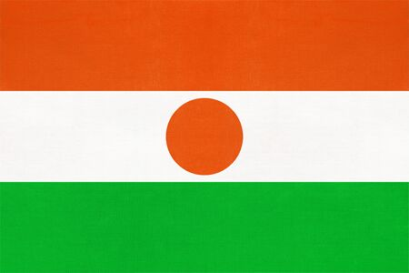 Republic Niger national fabric flag textile background. Symbol of international world african country. State official africa sign.