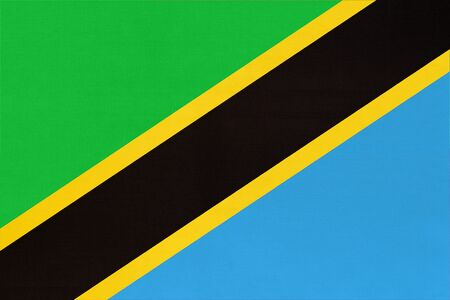 Republic Tanzania national fabric flag textile background. Symbol of international world african country. State official Tanzanian sign.