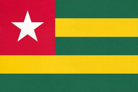 Republic Togolese national fabric flag textile background. Symbol of international world african country. State official Togo sign.