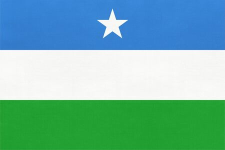 Puntland national fabric flag textile background. Symbol of international world african country. State official africa sign.