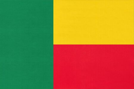 Republic Benin national fabric flag textile background. Symbol of international world african country. State official beninese sign. Stock Photo