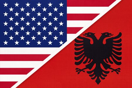 USA vs Albania national flag from textile. Relationship, partnership and economic between two american and european countries.