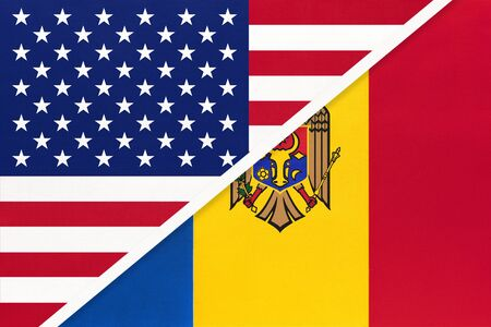 USA vs Moldova national flag from textile. Relationship, partnership and economic between two american and european countries. Banco de Imagens