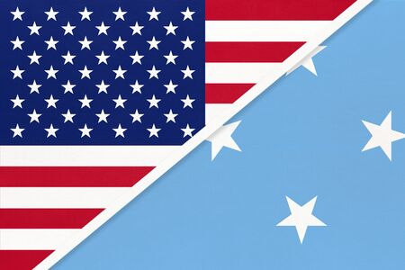 USA vs Federated States of Micronesia national flag from textile. Relationship, partnership and economic between two american and Oceania countries. Banco de Imagens
