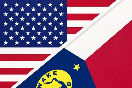 USA vs Wake Island national flag from textile. Relationship, partnership and economic between two american and Oceania countries. Banco de Imagens