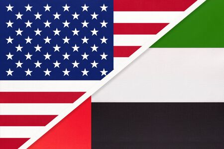 USA vs United Arab Emirates national flag from textile. Relationship, partnership and economic between two american and asian uae countries.