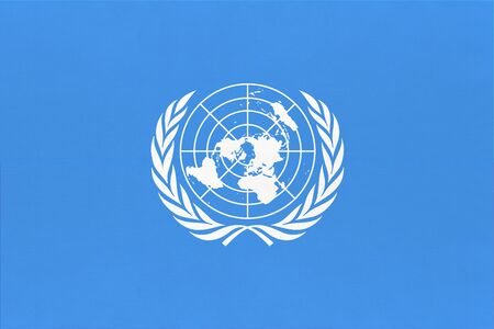 The United Nations UN official flag. Sign of the international community of world.