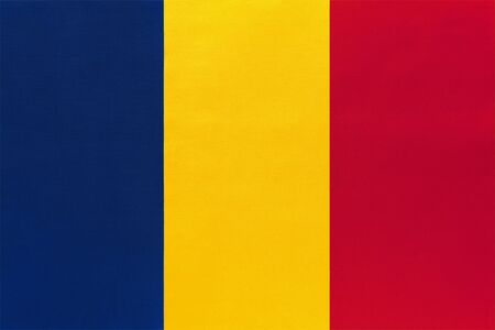 Republic of Chad national fabric flag, textile background. Symbol of international world african country. State official africa sign.