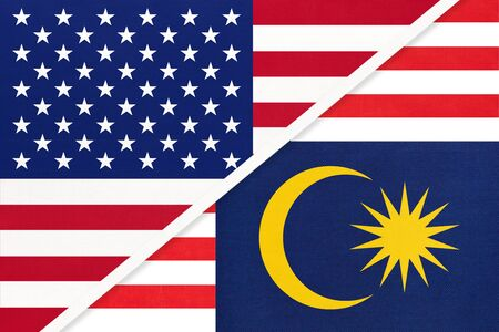 USA vs Malaysia national flag from textile. Relationship, partnership and economic between two american and asian countries.
