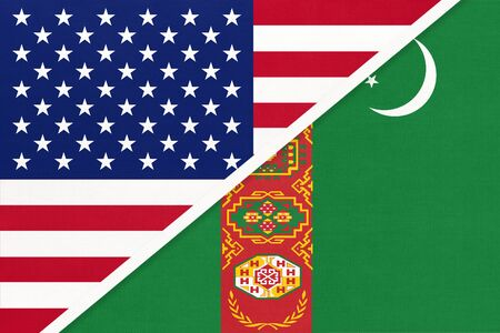 USA vs Turkmenistan national flag from textile. Relationship, partnership and economic between two american and asian countries.