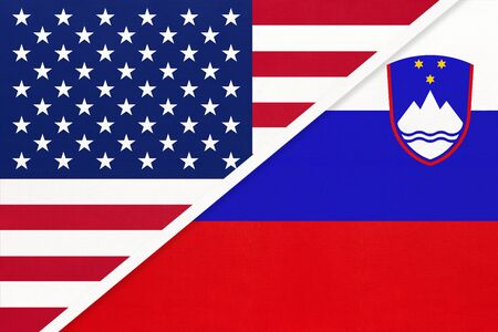USA vs Slovenia national flag from textile. Relationship, partnership and economic between two american and european countries.
