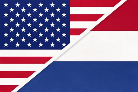 USA vs Netherlands national flag from textile. Relationship, partnership and economic between two american and european countries.