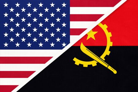 USA vs Republic of Angola national flag from textile. Relationship, partnership and economic between two american and african countries. Imagens