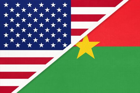USA vs Burkina Faso national flag from textile. Relationship, partnership and economic between two american and african countries. Imagens