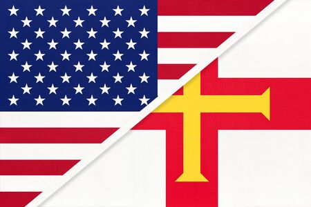 USA vs Bailiwick of Guernsey national flag from textile. Relationship, partnership and economic between two american and european countries. Imagens