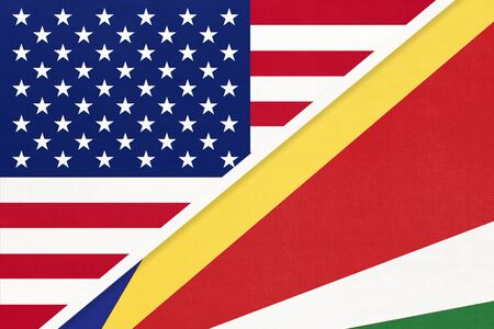 USA vs Republic of Seychelles national flag from textile. Relationship, partnership and economic between two american and african countries.