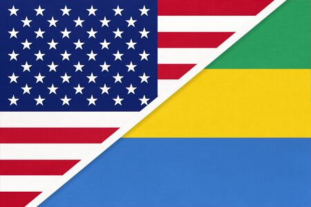 USA vs Gabonese Republic national flag from textile. Relationship, partnership and economic between two american and african Gabon countries. 스톡 콘텐츠