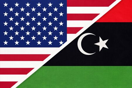 USA vs State of Libya national flag from textile. Relationship, partnership and economic between two american and african countries.