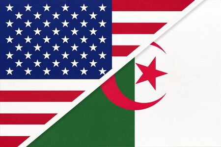 USA vs Republic of Algeria national flag from textile. Relationship, partnership and economic between two american and african countries.
