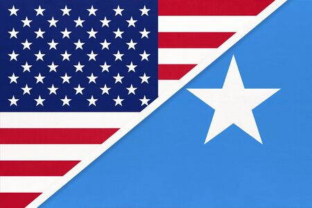 USA vs Federal Republic of Somalia national flag from textile. Relationship, partnership and economic between two american and african countries.