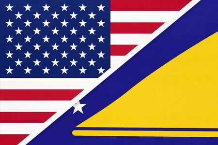 USA vs Tokelau national flag from textile. Relationship, partnership and economic between two american and Oceania countries. Imagens