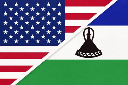 USA vs Kingdom of Lesotho national flag from textile. Relationship, partnership and economic between two american and african countries.