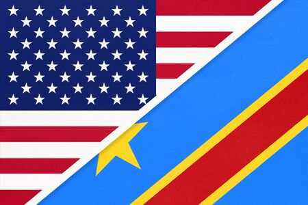 USA vs Democratic Republic of the Congo national flag from textile. Relationship, partnership and economic between two american and african countries. DRC Imagens