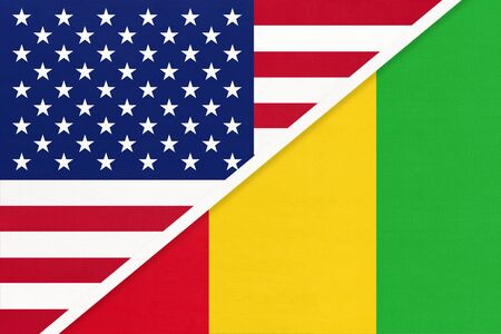 USA vs Republic of Guinea national flag from textile. Relationship, partnership and economic between two american and african countries.