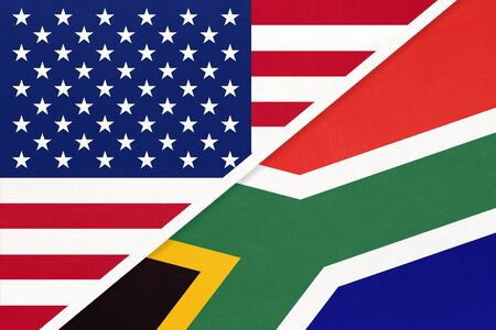 USA vs Republic of South Africa national flag from textile. Relationship, partnership and economic between two american and african countries. RSA Imagens