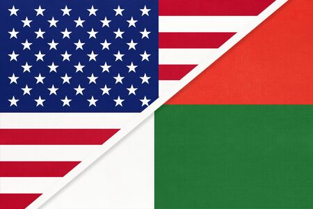USA vs Republic of Madagascar national flag from textile. Relationship, partnership and economic between two american and african countries. Imagens