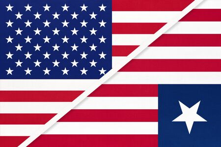 USA vs Republic of Liberia national flag from textile. Relationship, partnership and economic between two american and african countries.