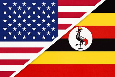 USA vs Republic of Uganda national flag from textile. Relationship, partnership and economic between two american and african countries.