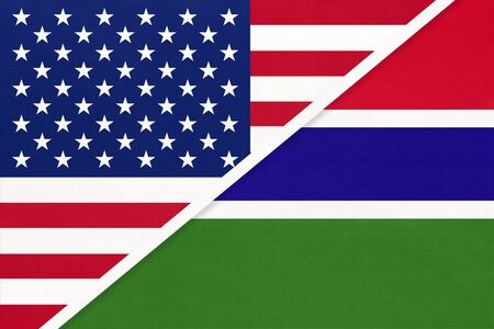 USA vs Republic of The Gambia national flag from textile. Relationship, partnership and economic between two american and african countries. Imagens