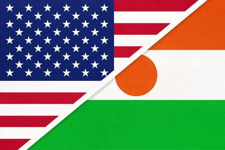 USA vs Republic of the Niger national flag from textile. Relationship, partnership and economic between two american and african countries.