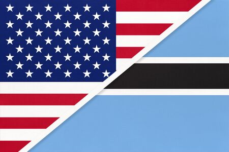 USA vs Republic of Botswana national flag from textile. Relationship, partnership and economic between two american and african countries. Imagens