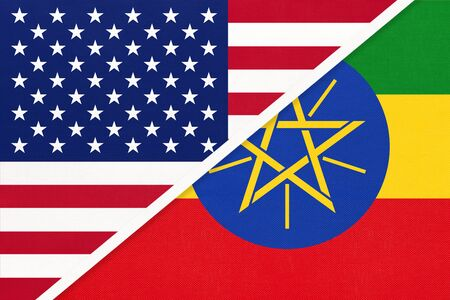 USA vs Federal Democratic Republic of Ethiopia national flag from textile. Relationship, partnership and economic between two american and african countries. Imagens